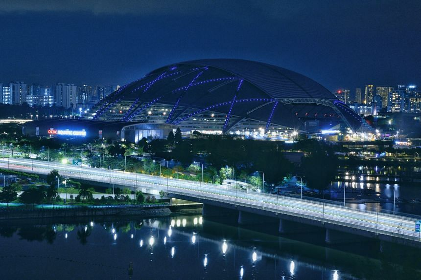 The Sports Hub lit in blue on March 21, 2021.