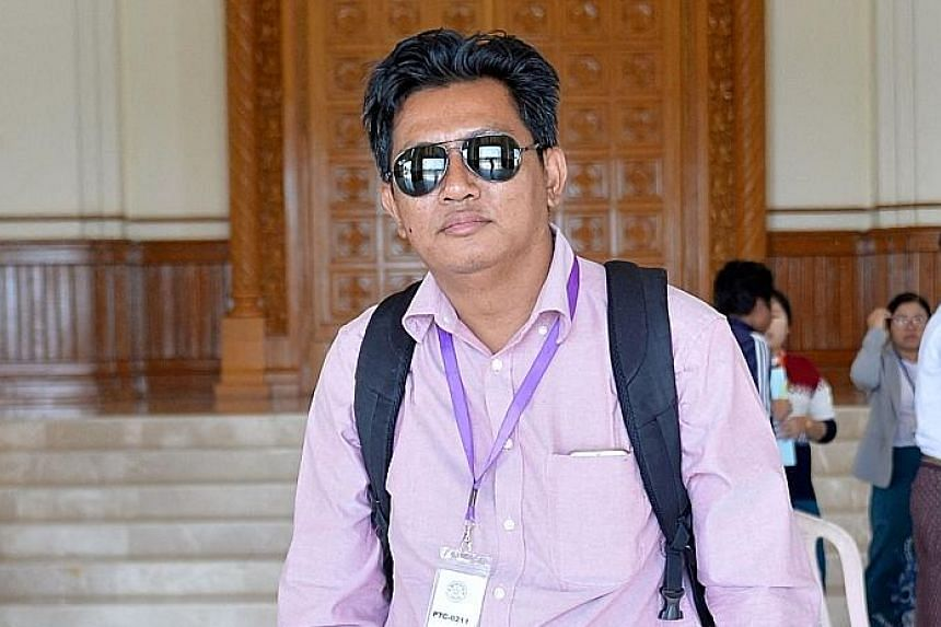 Below: Mr Aung Thura, a journalist with the BBC's Burmese service, had been detained by men in plain clothes while reporting outside a court in Myanmar's capital Naypyitaw on Friday. The broadcaster confirmed yesterday in a news story on its website
