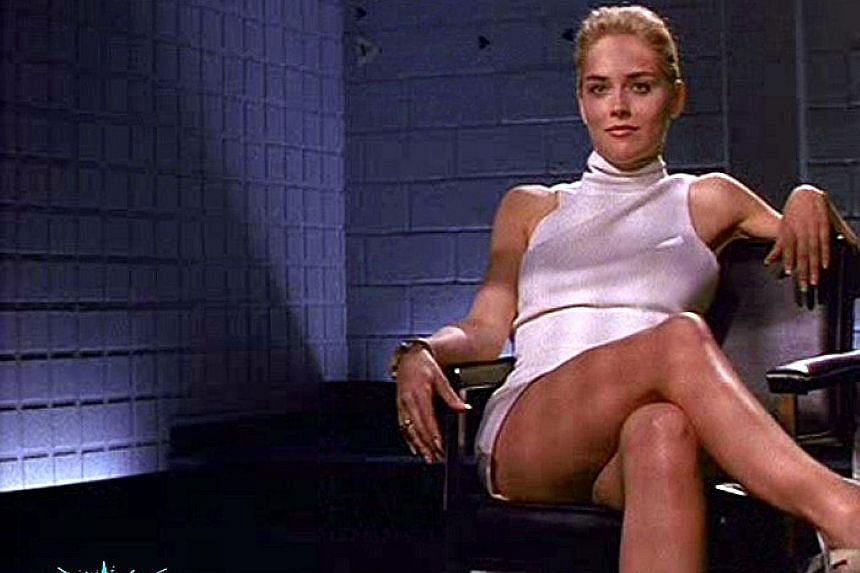 Sharon Stone in the infamous scene in Basic Instinct (1992) where she crosses and uncrosses her legs while being interrogated as a murder suspect by a roomful of men.
