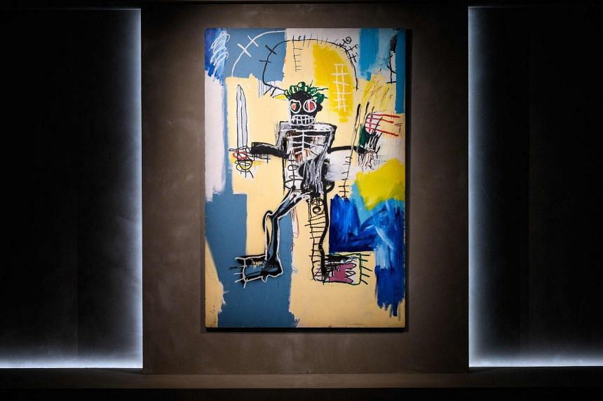 Artist Jean-Michel Basquiat's 1982 painting, 'Warrior' is seen displayed at the Christies auction house showroom in Hong Kong, on March 22, 2021.