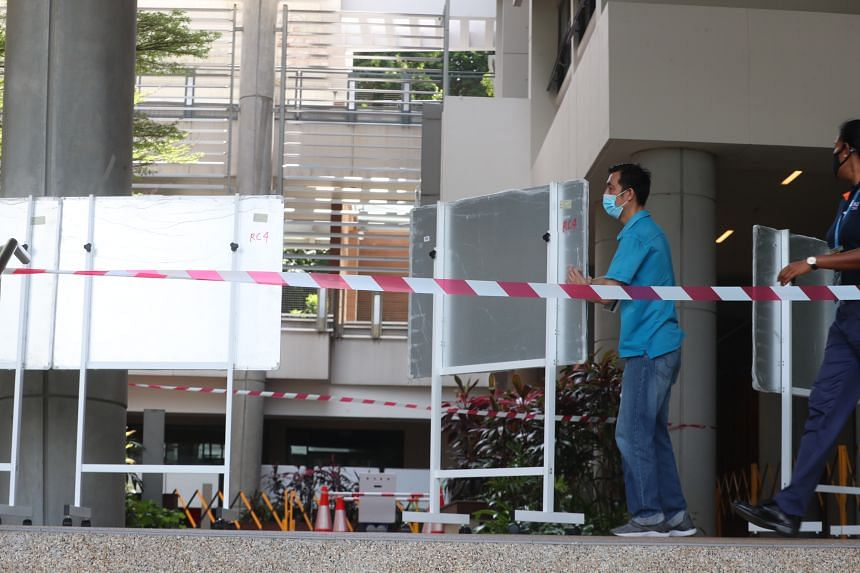 The open area between South tower and North Tower at Utown Residence being cordoned off for the set up of swabbing stations.