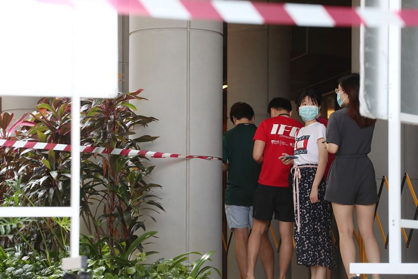Utown residents at NUS queuing up to take the swab test at the open area between South Tower and North Tower.