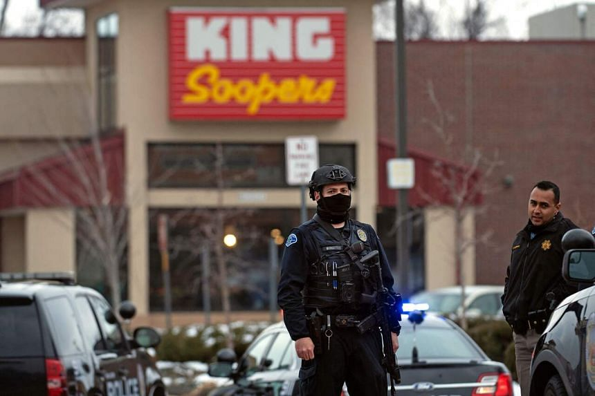 Police officers secure the perimeter of the King Soopers grocery store in Boulder, Colorado, on March 22, 2021.