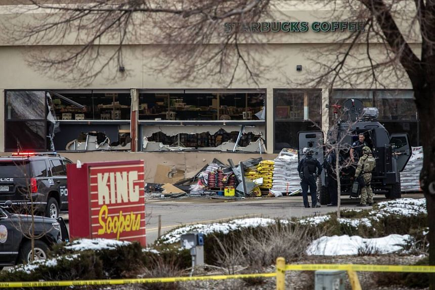 Tactical police units responding to the scene of a shooting at King Soopers grocery store in Boulder, Colorado, on March 22, 2021.
