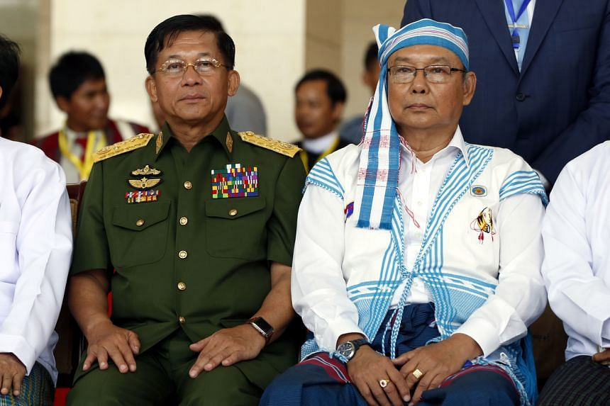 Myanmar military commander-in-chief Senior General Min Aung Hlaing (left) sit for a group photo in Myanmar, on May 24, 2017.