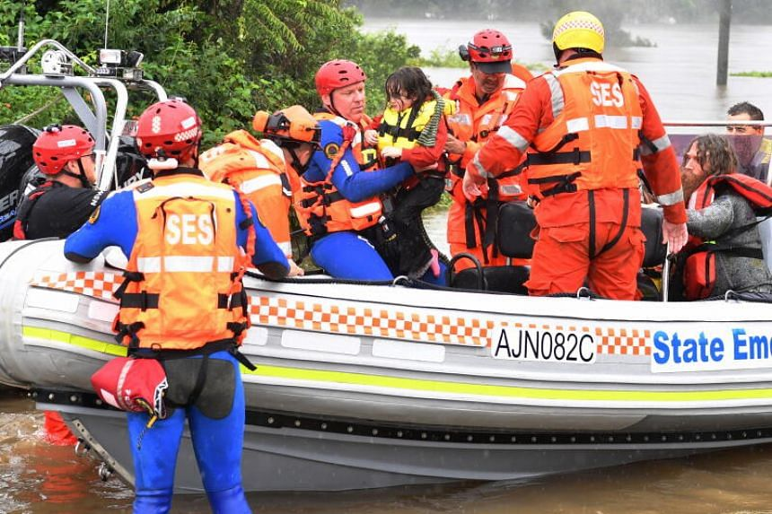 Rescuers evacuating a family of four from a flooded property in Upper Colo, in Sydney, on March 23, 2021.