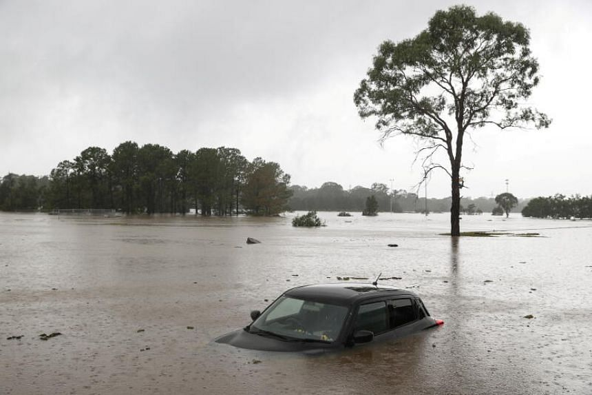 A partially submerged car that was abandoned in floodwaters in the suburb of Windsor, New South Wales, on March 22, 2021.