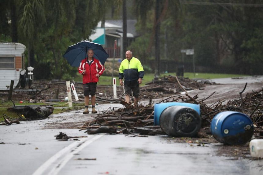 Residents observe flood damage in Port Macquarie in New South Wales on March 23, 2021.