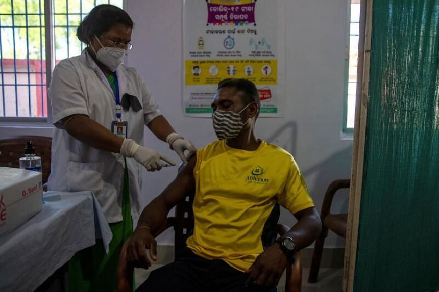 A sanitation worker receiving the Covid-19 vaccine in the Koraput district of Odisha, India, on Jan 16, 2021.