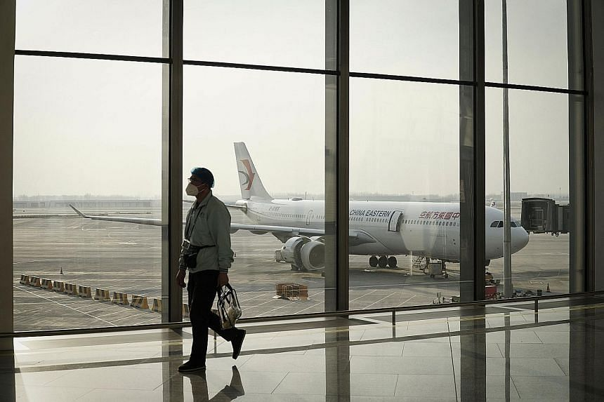 Daxing International Airport in Beijing. To stop the coronavirus, China bans tourists and short-term business travellers outright, and it sets tough standards for all other foreigners, even those who have lived there for years. The restrictions have