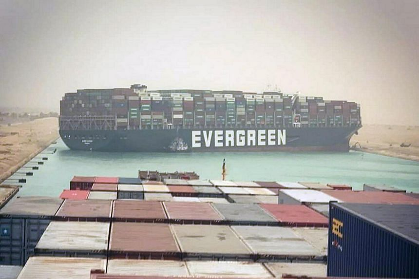 Jammed container ship causes enormously costly traffic jam in Suez Canal
