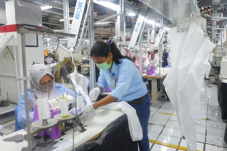 Workers from PT Pan Brothers Tbk & Group, the largest garment manufacturer in Indonesia with multiple factories across Java, producing washable and waterproof jumpsuits at its factory in Banten, on April 4, 2020.