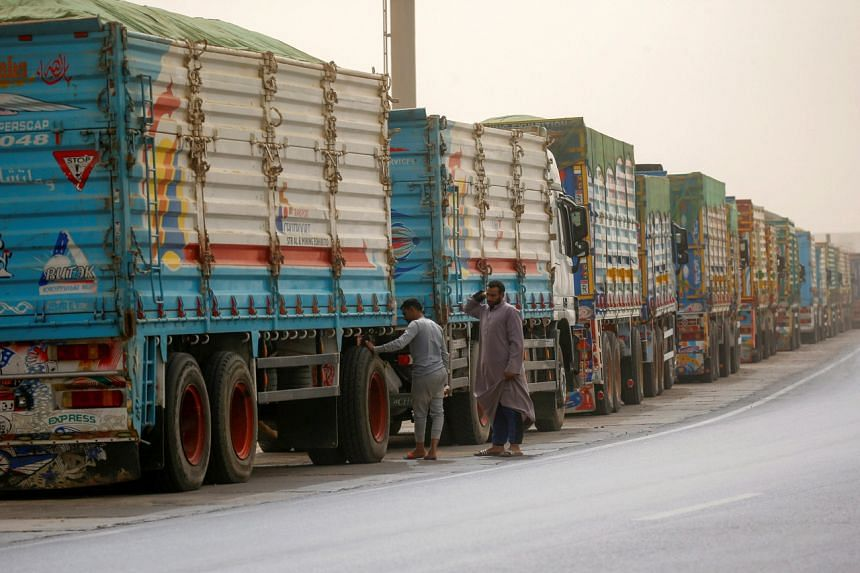 Trucks waiting to pass through the main gate of the El Ain El Sokhna port to Suez Canal on March 24, 2021.