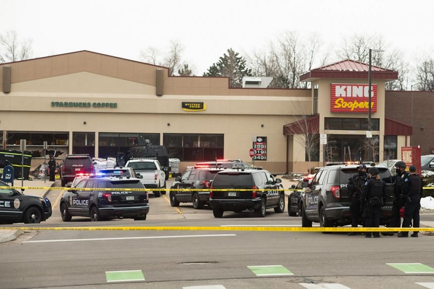 Police vehicles in the parking lot of the Boulder King Soopers grocery store after a shooting that killed multiple people in Boulder, Colorado, on March 22, 2021.