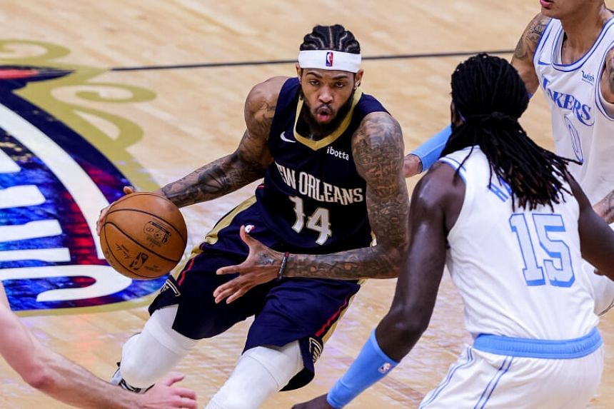 New Orleans Pelicans forward Brandon Ingram dribbles during the NBA match at Smoothie King Center, on March 23, 2021.