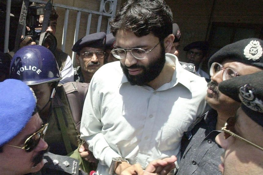 Police escorting British-born Ahmed Omar Saeed Sheikh out of a court in Karachi in a photo taken in 2002.