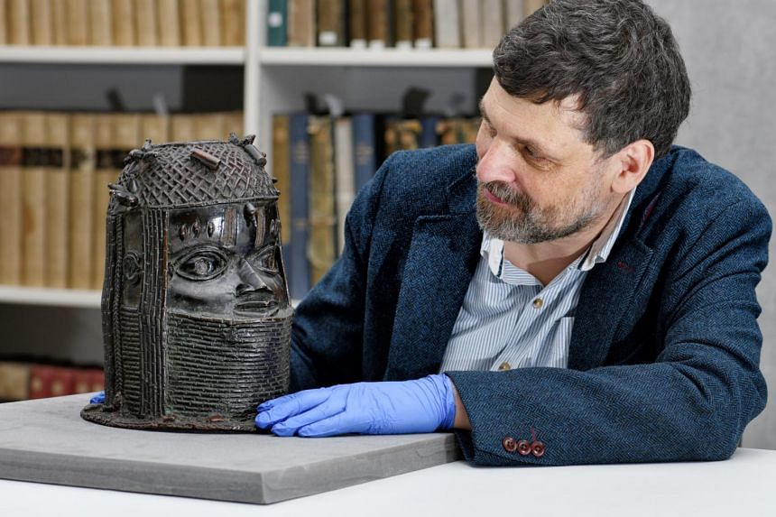 Aberdeen's head of museums and special collections Neil Curtis with the Bronze of a ruler of the Kingdom of Benin.