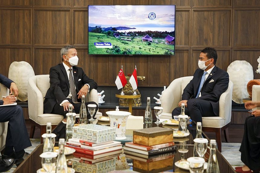 Foreign Minister Vivian Balakrishnan (left) with Indonesian Minister of Tourism and Creative Economy Sandiaga Uno.