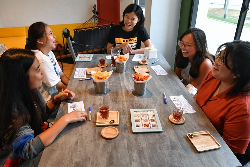 Ms Yong Yoek Ling (centre), founder of Bold At Work, which is involved in organising a pop-up conversation bar that gets participants to select and explore themes on mental wellness.