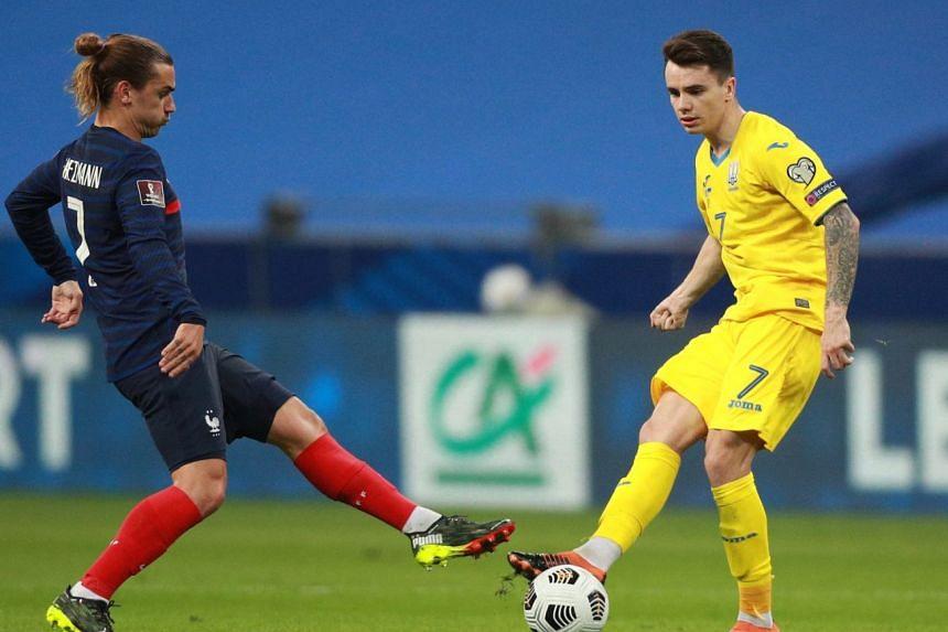 France's Antoine Griezmann (left) and Ukraine's Mykola Shaparenko in action during their World Cup qualifier match on March 24, 2021.