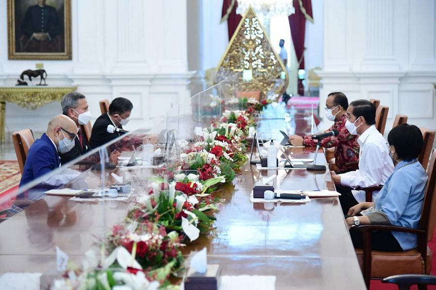 Singapore Foreign Minister Vivian Balakrishnan (second from left) meeting with Indonesian President Joko Widodo (second from right) and Indonesian Foreign Minister Retno Marsudi (right) on March 26, 2021.