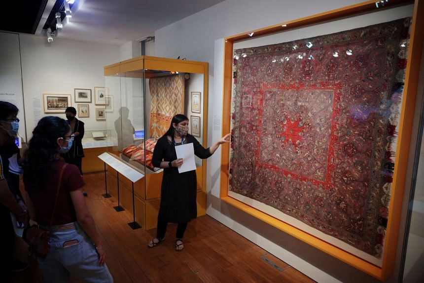 Indian Heritage Centre assistant curator Malvika Agarwal sharing about an embroidered shawl from North India.
