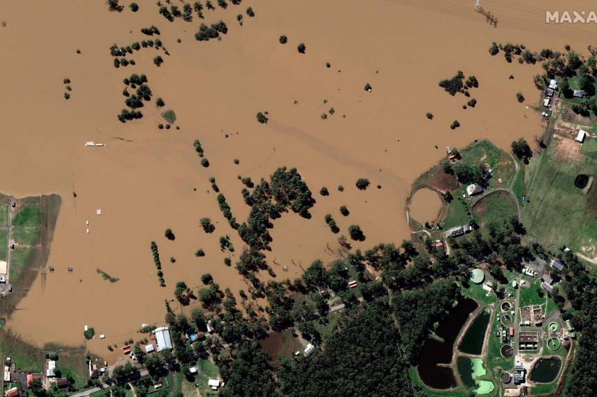 A satellite image shows the significant flooding taking place in and around Windsor, Australia, on March 25, 2021.