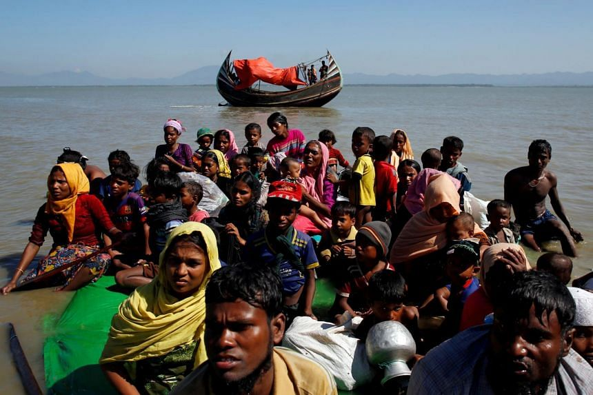 A photo from November 2017 shows Rohingya refugees sitting on a makeshift boat. A group of Rohingya were found by the Indian Coast Guard last month off the Andaman coast.