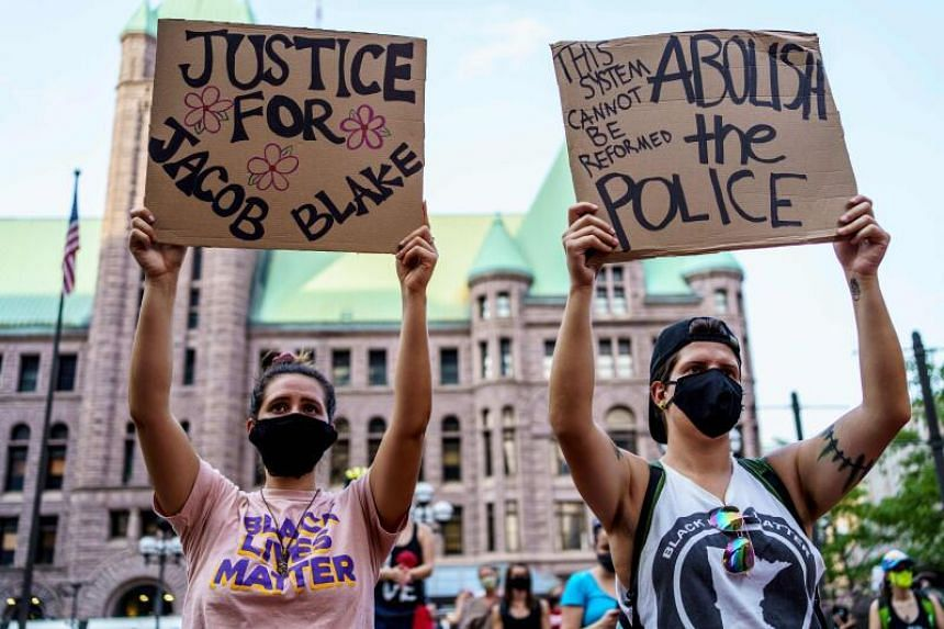 Protesters holding signs in support of Mr Jacob Blake outside the Hennepin County Government Plaza in Minneapolis, Minnesota, on Aug 24, 2020.