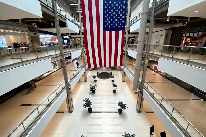 Shoppers in the nearly empty Palisades Centre Mall in West Nyack, New York, earlier this year. Retailers in the US are abandoning enclosed malls in growing numbers as the rise of online shopping transforms the industry – a trend that has accelerate