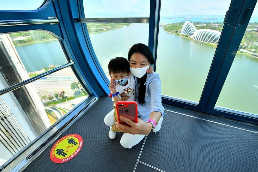 Madam Ong Geok Heong taking a wefie with her grandson, Izaac Ng at Singapore Flyer on March 28, 2021.