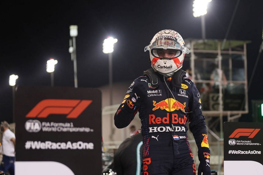 Red Bull's Max Verstappen celebrates after qualifying in pole position at the Bahrain Grand Prix, on March 27, 2021.