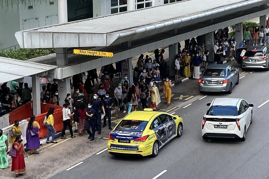 A crowd gathering at a taxi stand outside Sengkang MRT station yesterday morning, after a power fault disrupted train services between Serangoon and Punggol MRT stations.
