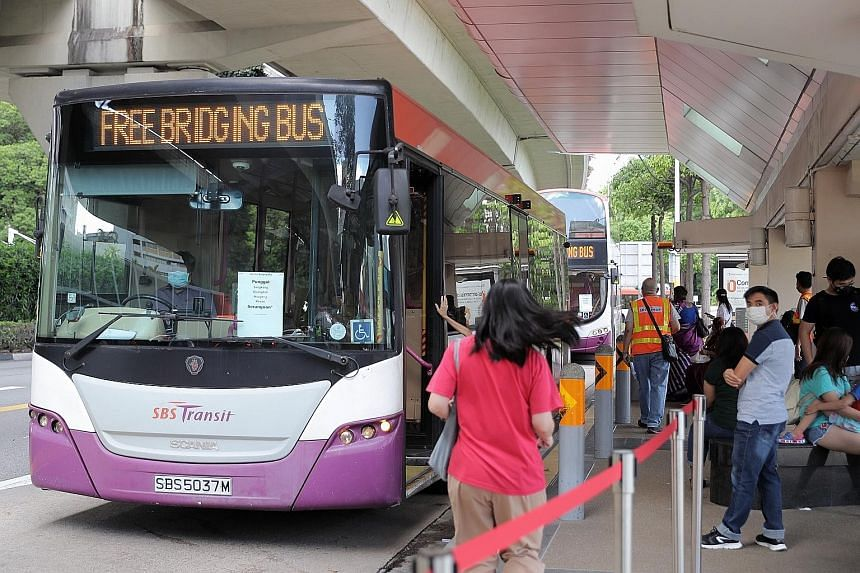 Train commuters had access to free regular and bridging bus services at designated bus stops between Serangoon and Punggol stations during the NEL disruption yesterday. ST PHOTO: GAVIN FOO