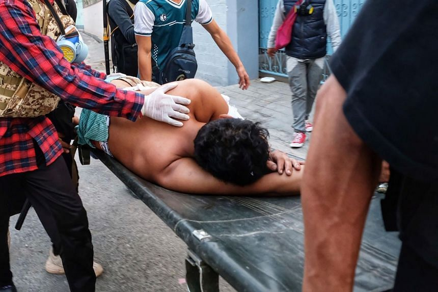 An injured protester being carried on a stretcher to a hospital in Taunggyi on March 28, 2021.