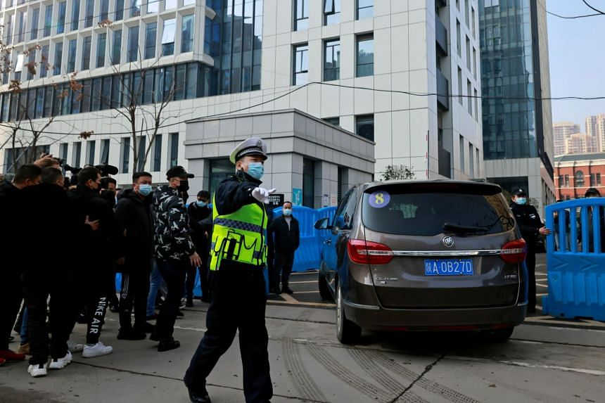 The convoy carrying the World Health Organisation team arrives at the Wuhan Center for Disease Control and Prevention in Wuhan, on Feb 1, 2021.