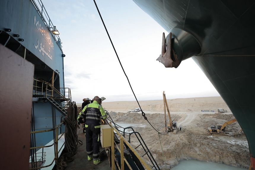 The Ever Given container ship as seen in the Suez Canal on March 28, 2021. Salvage teams had intensified excavation and dredging around the massive container ship.