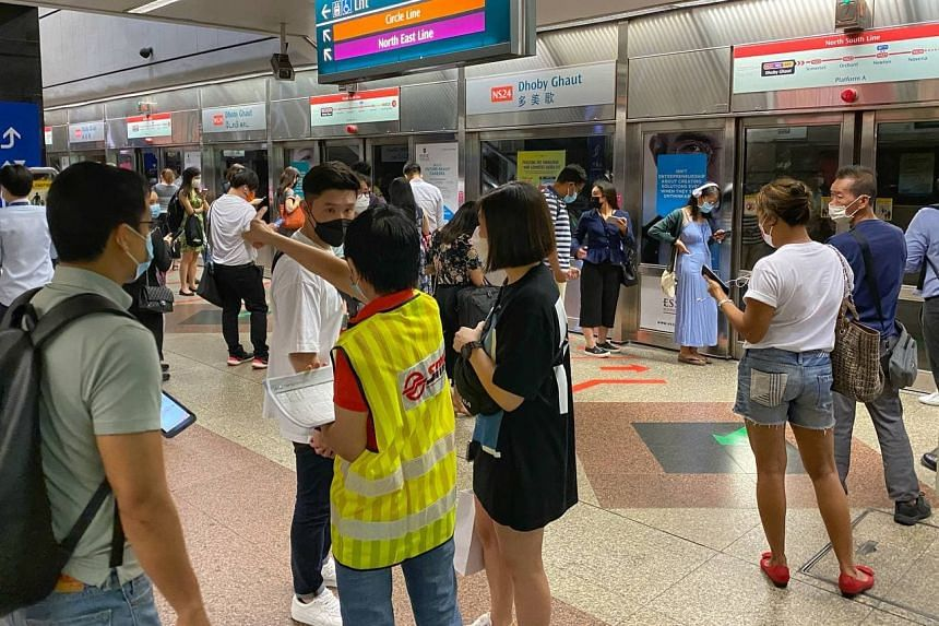 Commuters at Dhoby Ghaut MRT station on the morning of March 29, 2021.