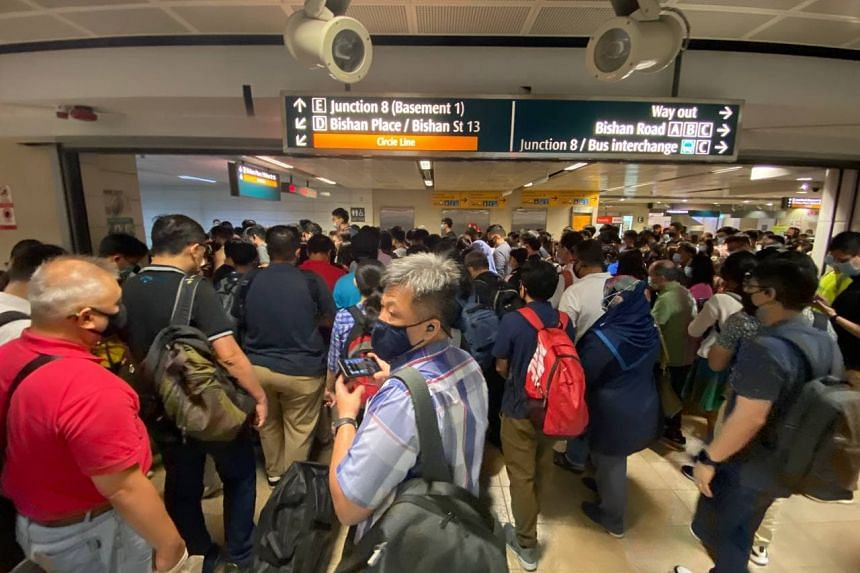 Commuters changing lines from the North-South Line to Circle Line at Bishan MRT station at 7.50am on March 29, 2021.