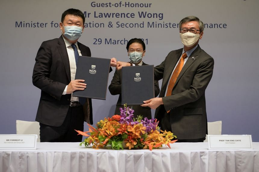 (From left) Sea founder and group CEO Forrest Li, Education Minister Lawrence Wong and NUS president Tan Eng Chye at the signing ceremony on March 29, 2021.