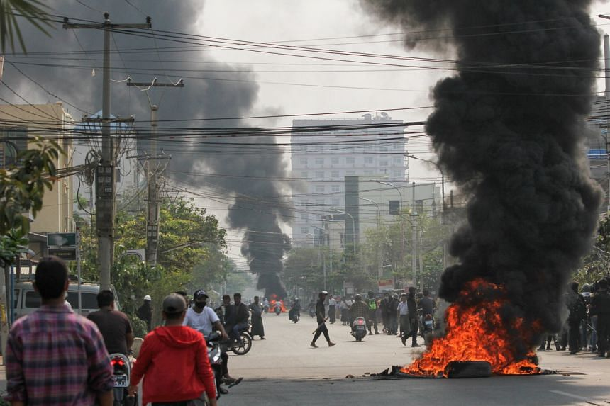 Tires burning on a street during a protest in Mandalay, Myanmar, on March 27, 2021.