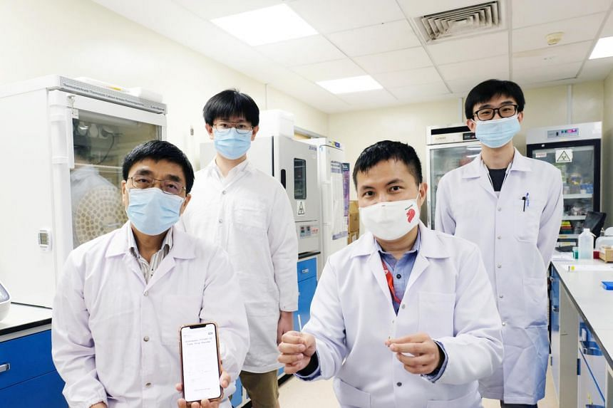 (From left) NTU School of Computer Science and Engineering's Professor Lin Weisi and PhD student Hou Jingwen, NTU School of Chemical and Biomedical Engineering's Associate Professor Tan Meng How and project officer Ooi Kean Hean.