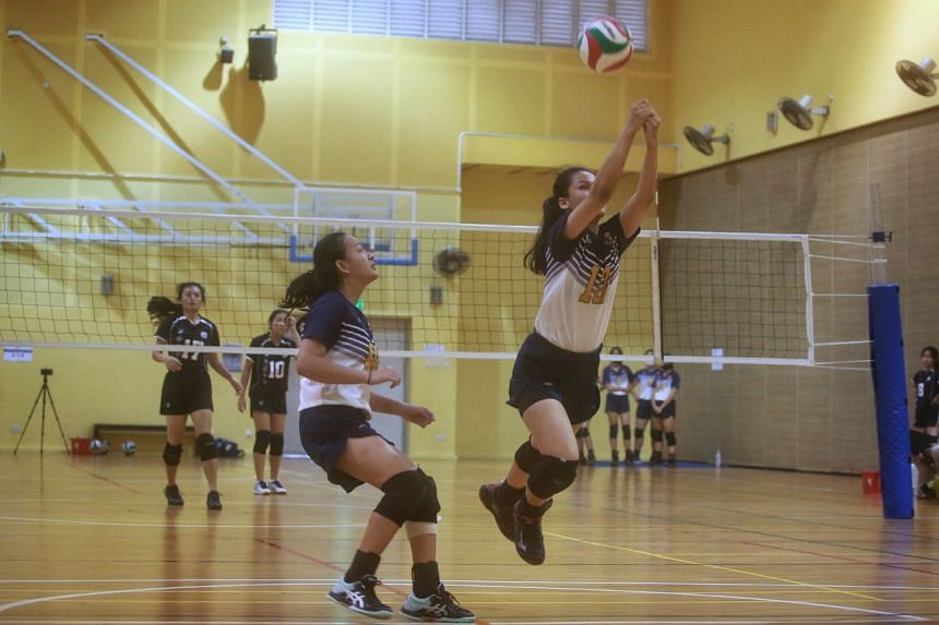 Paya Lebar Methodist Girl's Secondary's Anessa Gurung making a save during her school's volleyball match against Chung Cheng High on March 29, 2021.