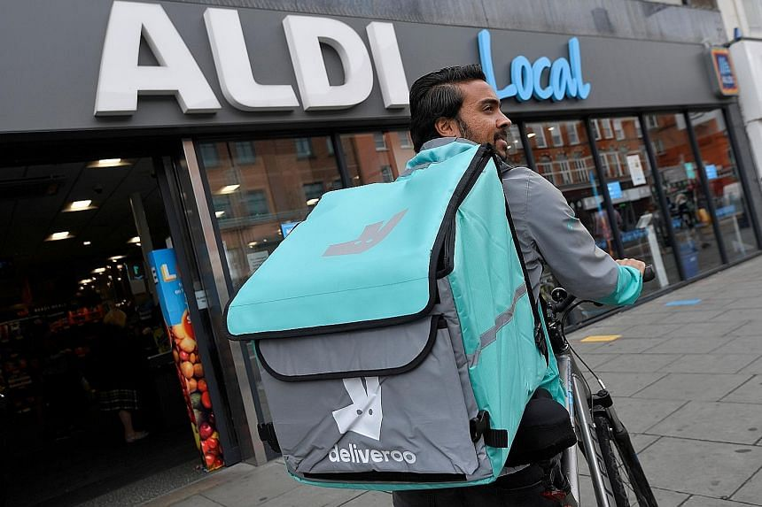 Deliveroo, whose 50,000 self-employed riders are a common sight in many British suburbs, is set for Britain's biggest stock market debut in nearly a decade. PHOTO: REUTERS
