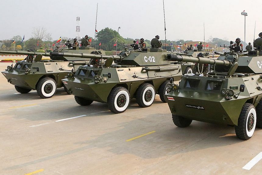 Armoured vehicles participating in the Armed Forces Day parade in Naypyitaw last Saturday. A steady diet of propaganda feeds soldiers notions of enemies at every corner, interviews revealed. The cumulative effect is a bunkered worldview in which orde