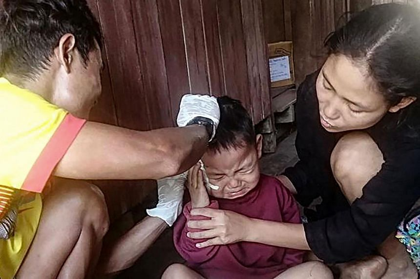 Saw Ta Eh Ka Lu Moo Taw has lacerations to his neck and has some fragments still in him.