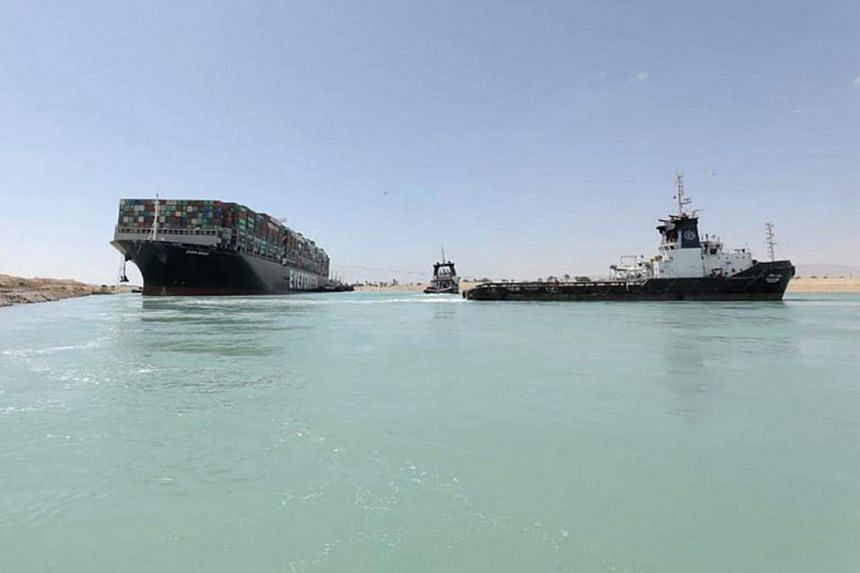 A tugboat pulling the Ever Given container ship after it was fully dislodged from the banks of the Suez Canal on March 29, 2021.