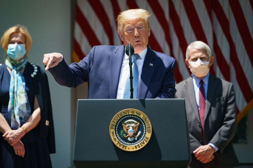 A file photo from May 15, 2020, showing Mr Donald Trump speaking on vaccine development in Washington DC, flanked by Dr Deborah Birx and Dr Anthony Fauci.
