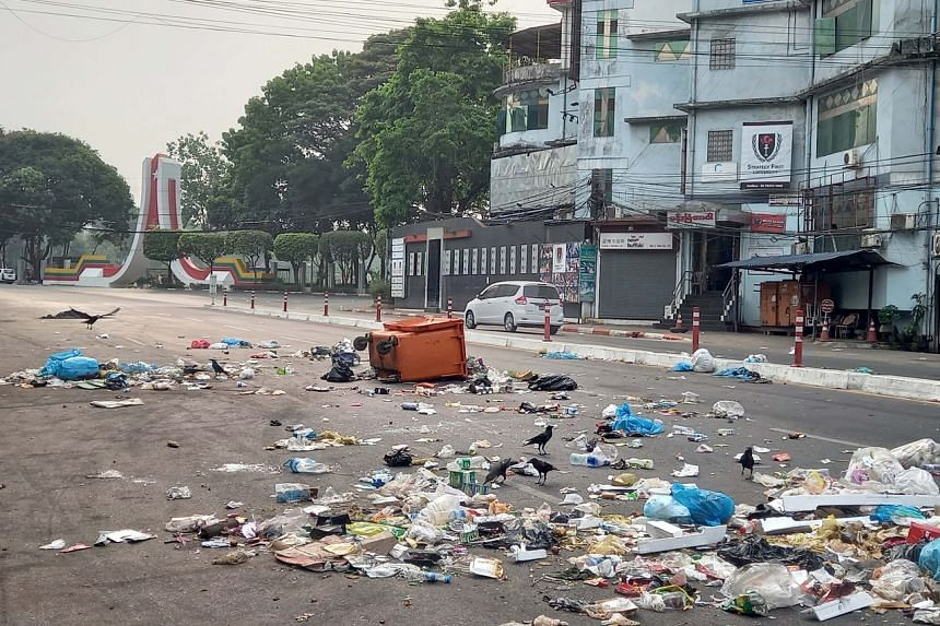 Protesters throwing garbage on the road to protest against the military coup in Yangon, Myanmar, on March 30, 2021.