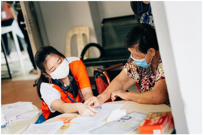 A volunteer with a senior citizen supported by TriGen's Project Wire Up initiative.